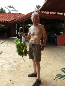 """Eddie with his """"catch"""" of bananas"""
