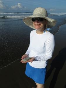 Ellen at Playa Linda with her find of sand dollars