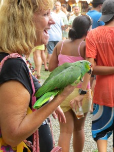 Woman with pet parrot who likes to ride around in her purse