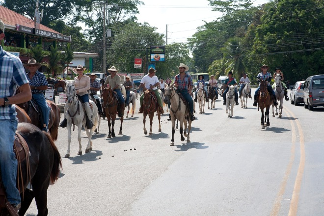 The horse parade begins down the main street in Uvita