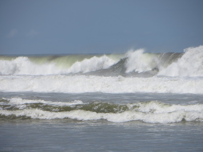 3 to 4 meter waves breaking at Playa Dominical