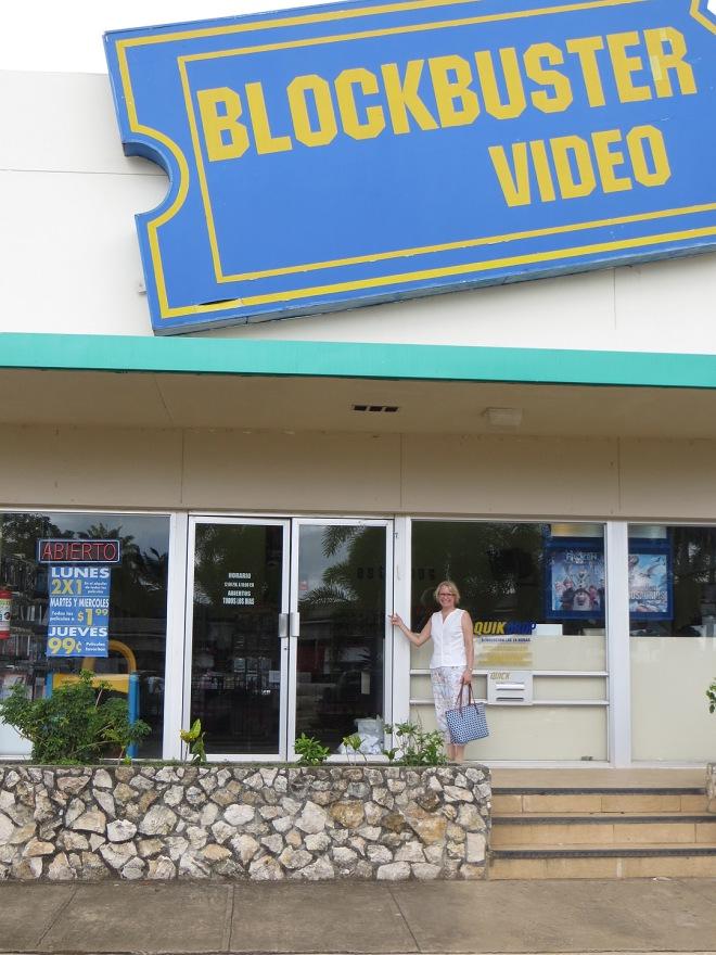 Ellen in front of an OPEN Blockbuster in David