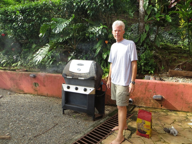 Eddie using the old gas grill to smoke spare ribs