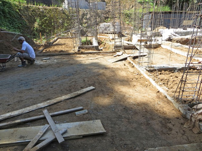This is the carport area now completely filled in  with dirt with the perimeter foundation walls just protruding out of the soil.
