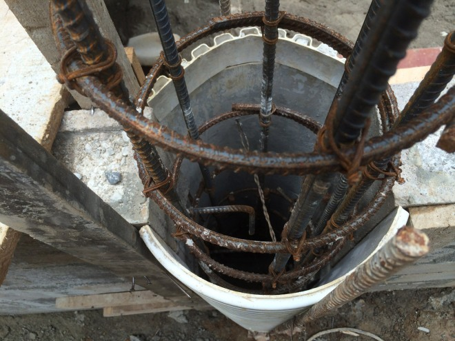 Construction of a circular column...re-bar reinforcement inside the white plastic form.