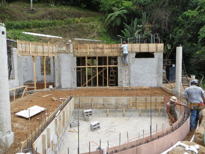Upper section of the pool walls are formed and ready for concrete.  In the background the forming of the crown beam be seen on the house.