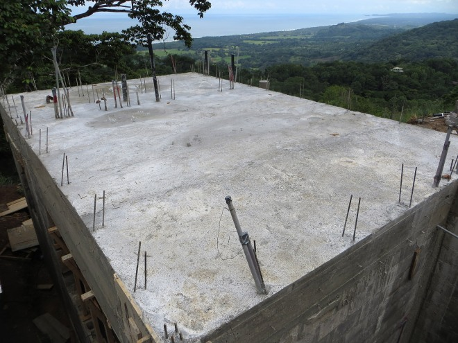 The second floor concrete is poured and forms have been removed.