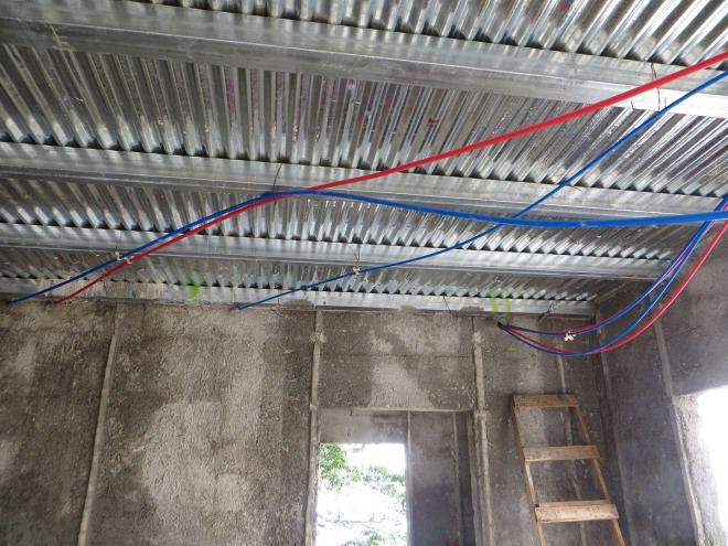 PEX lines for the second floor are routed below and will be covered when the ceiling is installed.