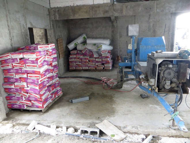 Here is a portion of the sacks of Repello that will be needed to finish all the walls of the house.  The product we are using is called Repemax.