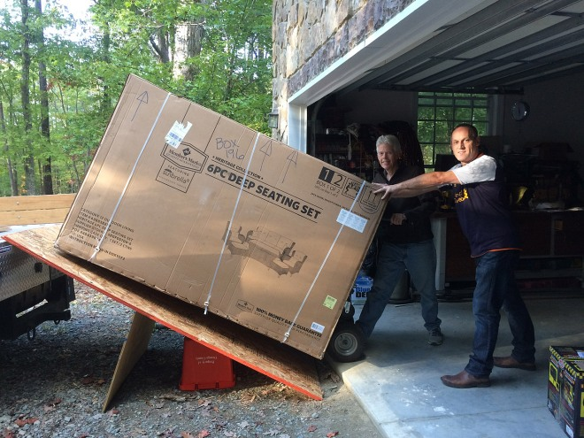 Sean, a friend of Mark and Jane's, helped Eddie load the huge box of outdoor furniture.