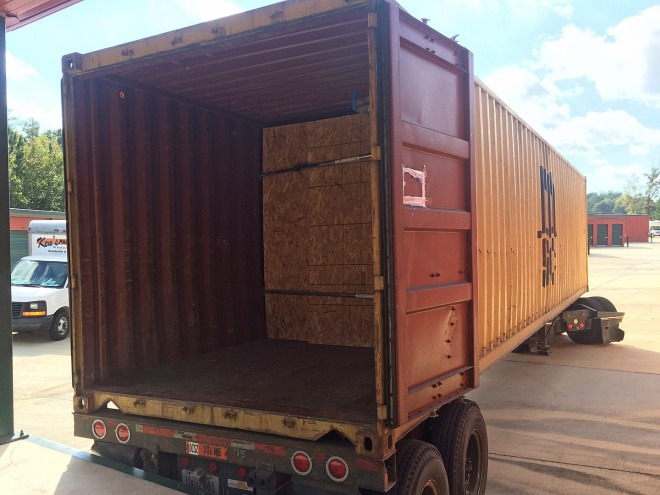 The container is loaded.  sheets of plywood and load lock bars secures everything in place.