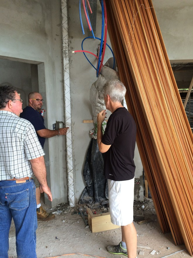 Eddie talking with cabinetmakers Caesar and Don Diego about some projects.