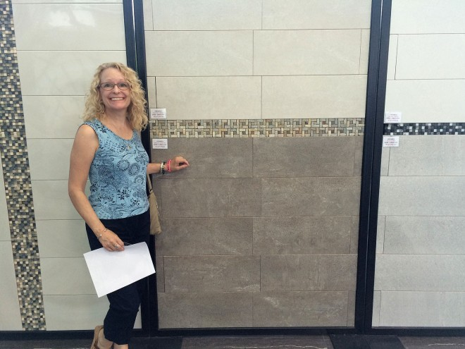 Ellen in front of the tile we are using in the master suite bathroom.