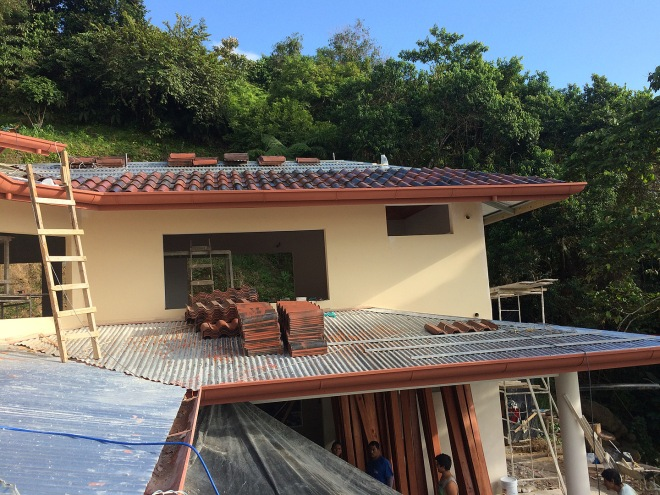 Roof tile installation has started.