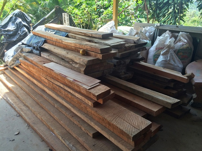 Raw lumber (Cedro Amargo) for the doors.