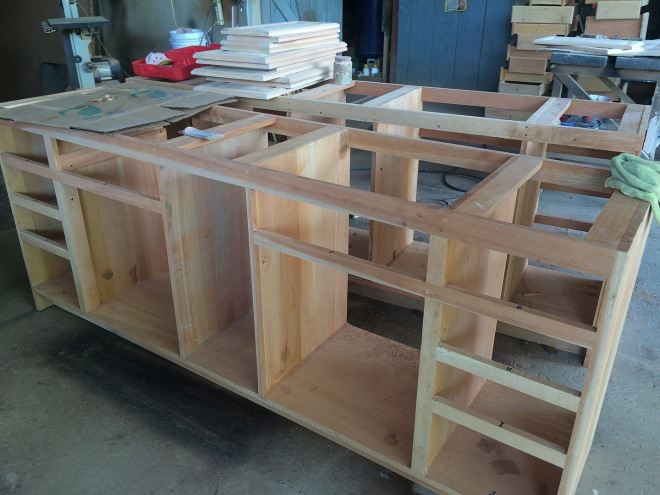 The bathroom vanity frames are in process.