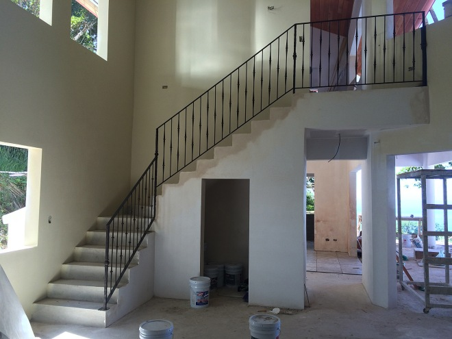 Wrought iron stair railing has been installed.  It will have a wood hand rail as well.
